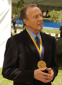 photo::ICS Donald Bren, wearing the UC Medal, meets with media after the June 9 event.