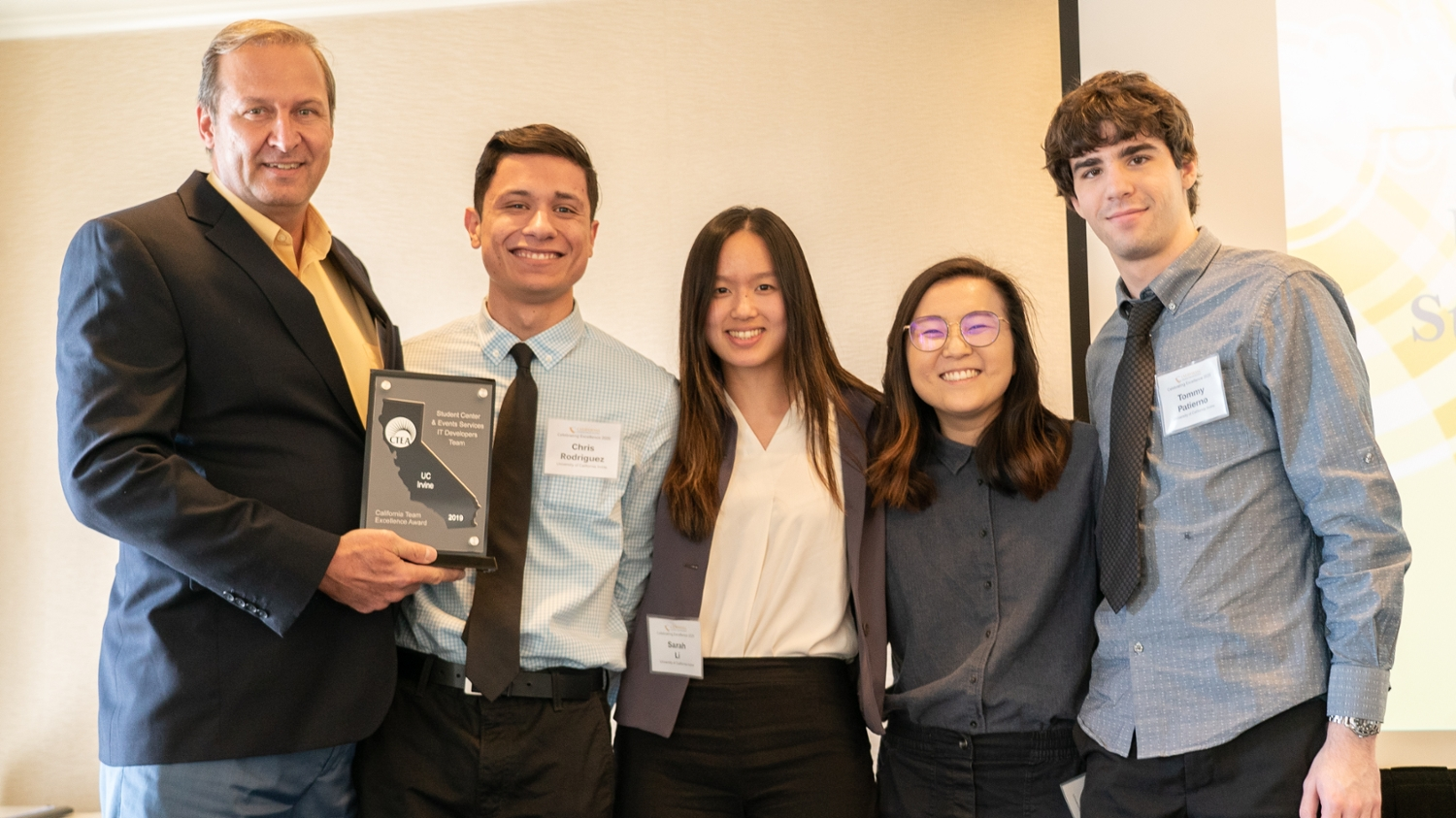 Marketing manager Brian Petyo holds the CTEA award with four members of his team of ICS students (from left): Chris Rodriguez, Sarah Li, Yuchen
