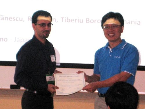 Microsoft VP Harry Shum presents award certificate to UCI team leader Yasser Ganjisaffar