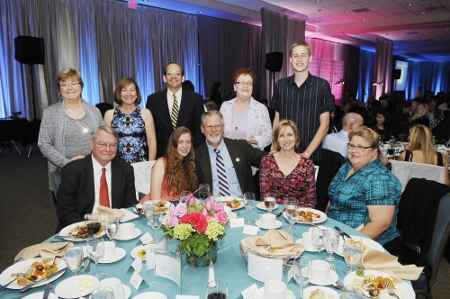Russell and his family with (from left) professors Judy and Gary Olson, Dean Hal Stern and his wife, Hara Waldman.