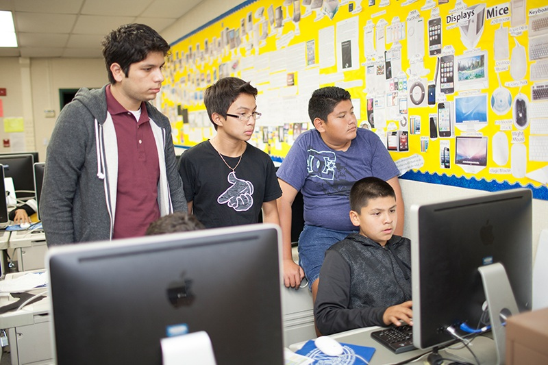 Mentor Daniel Tenorio works with the AppJam+ students at the Boys and Girls Club of Garden Grove.