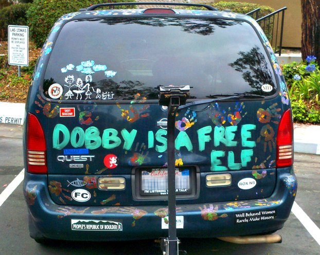 Nissan Quest minivan painted to say 'Dobby is a free elf'