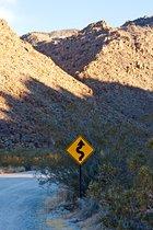 Curves ahead sign at Indian Cove, Joshua Tree National Park, California