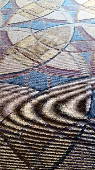 Circle arrangement pattern in the carpet at LAX