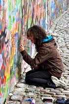 Painter at the John Lennon graffiti wall, Prague