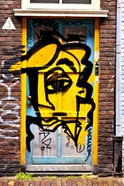 Yellow face, graffiti in Spui, Amsterdam