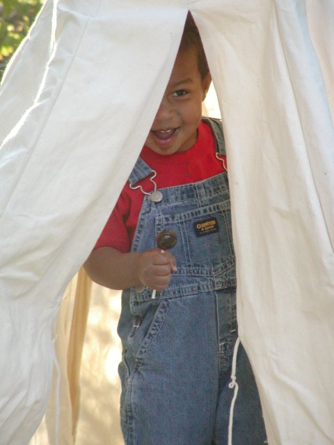 Miles emerges from the tepee